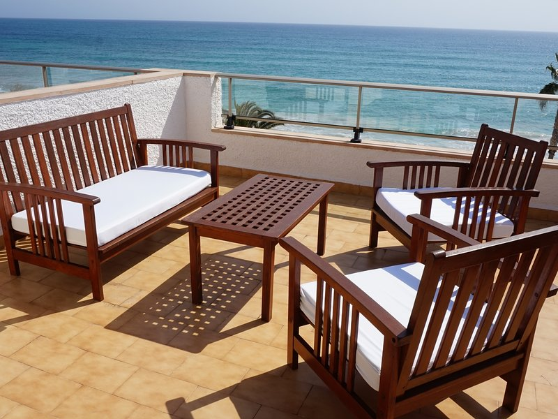 Apartment with terrace by the beach with sea view - Antic 201, location de vacances à S'illot