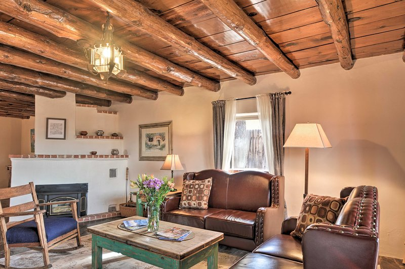 The interior features adobe decor and exposed wood-beam ceilings.