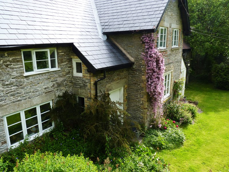 The Old Farmhouse (left) from the front.  The adjoining Lodge Cottage (also to let) is on the right.