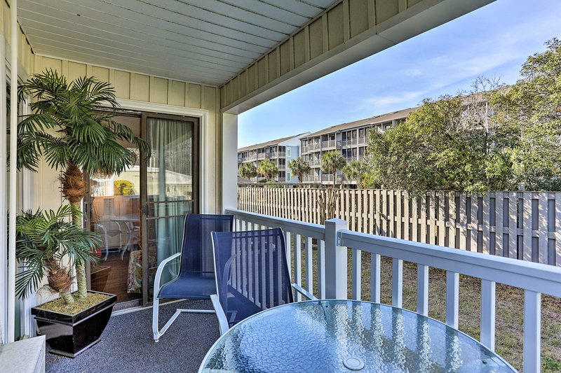 Relax on the private balcony and enjoy the ocean breeze.