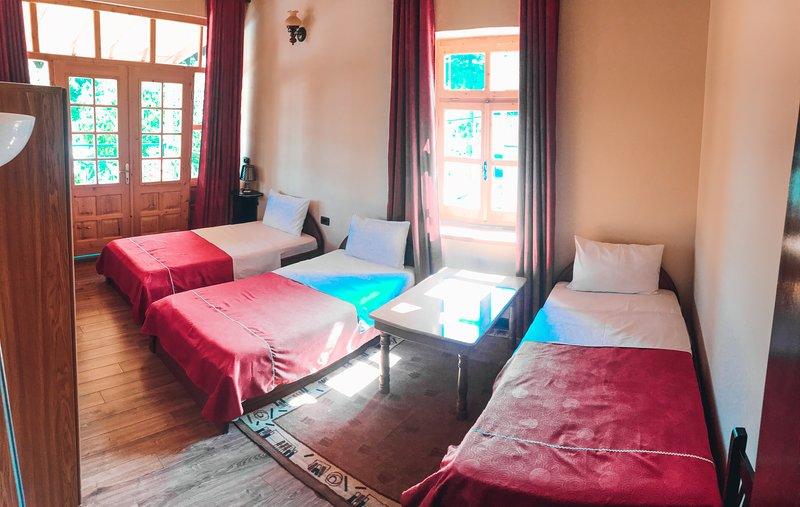 Bedroom 2. 3 single beds.