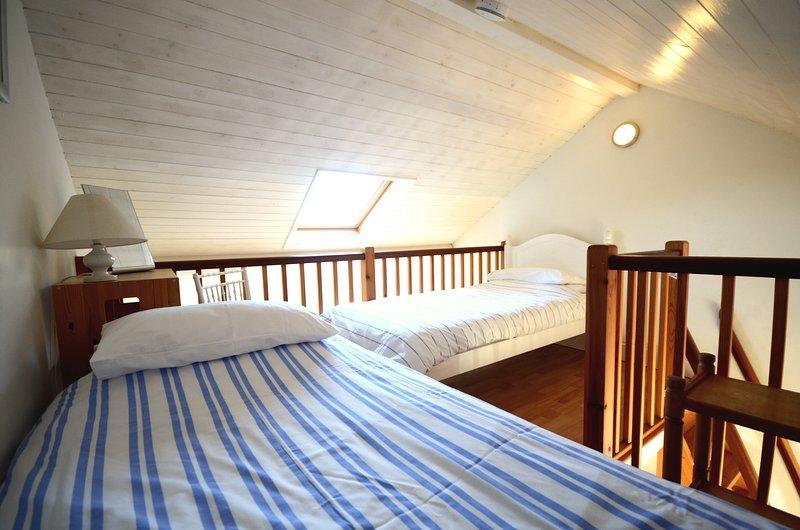 Twin beds on the mezzanine floor
