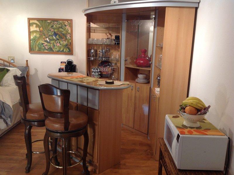 Basic kitchenette - microwave, refrigerator, coffee maker, etc.