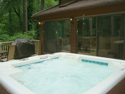 Let the good times roll in the cool green mountains of western NC!  Private hot tub in the woods!