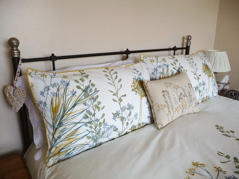 Your relaxation starts here....Beautiful linens...in our King Size bed.