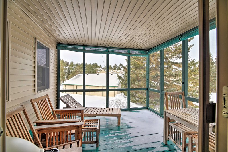 The 4-bedroom, 3-bathroom abode features a furnished, screened-in porch.