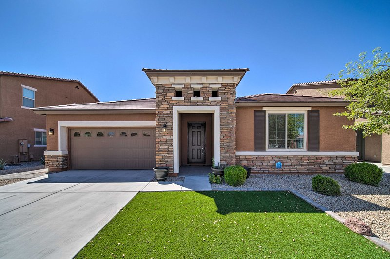 Book a trip to this newly built, 3-bed, 3-bath vacation rental home in Goodyear.