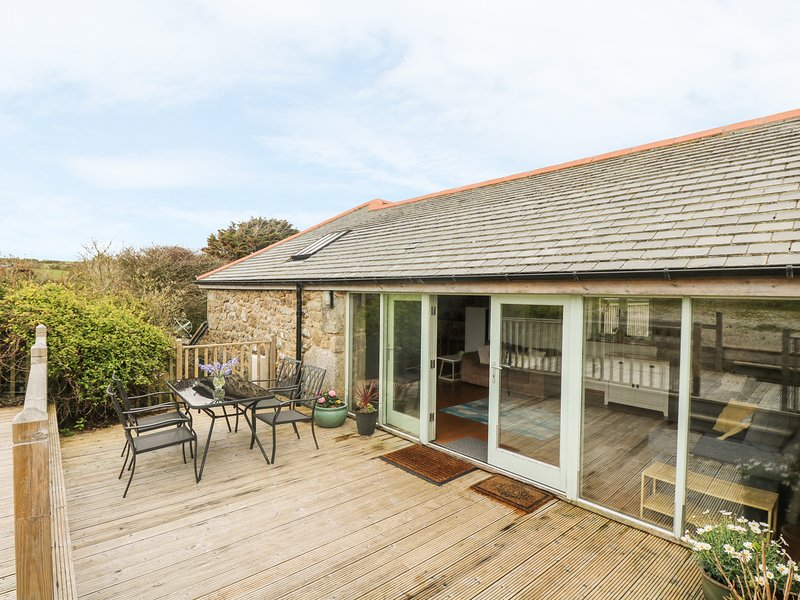 THE OLD BARN, two-storey, semi-detached barn conversion, countryside near, vacation rental in St Buryan