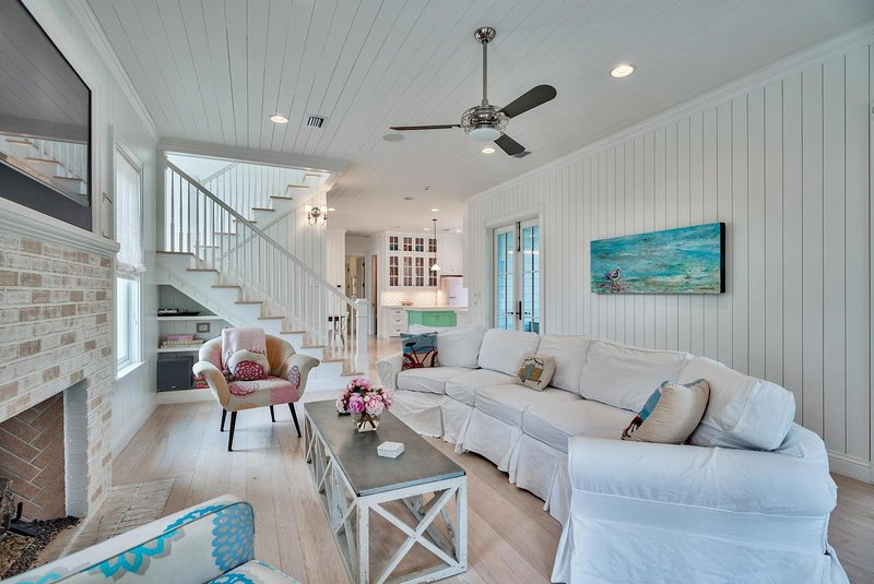 The Little Beach House features a large living room with plenty of seating
