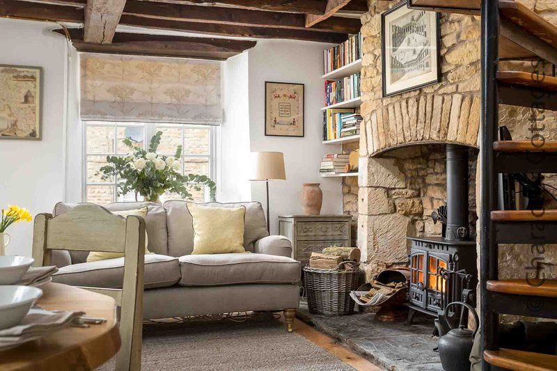 The beautiful living room is full of character including a cosy wood burning stove