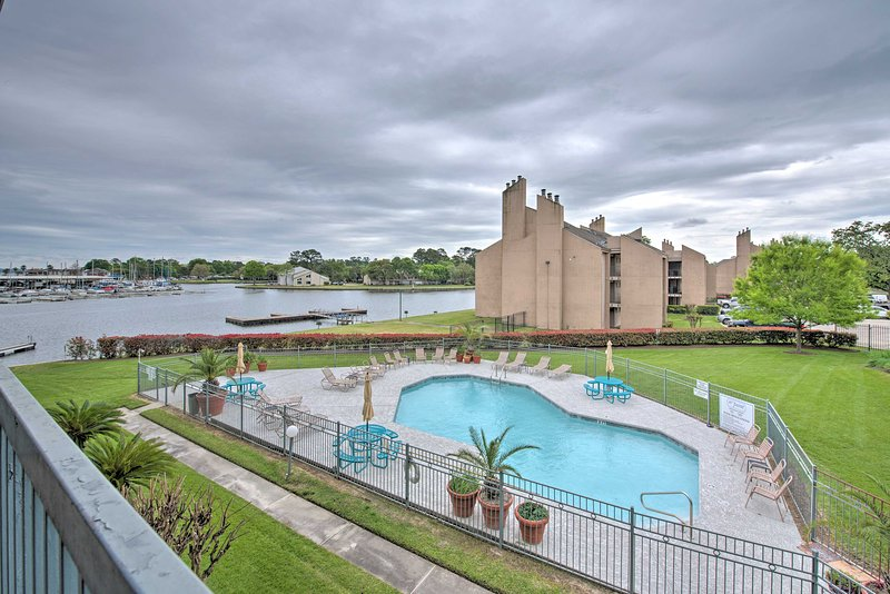 Clear the calendar for a summertime trip to this vacation rental on Lake Conroe!