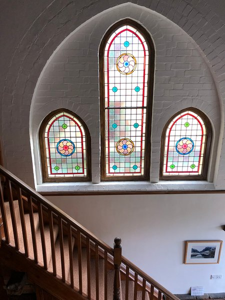 Stain glassed window above second stair case to spacious landing and bedrooms