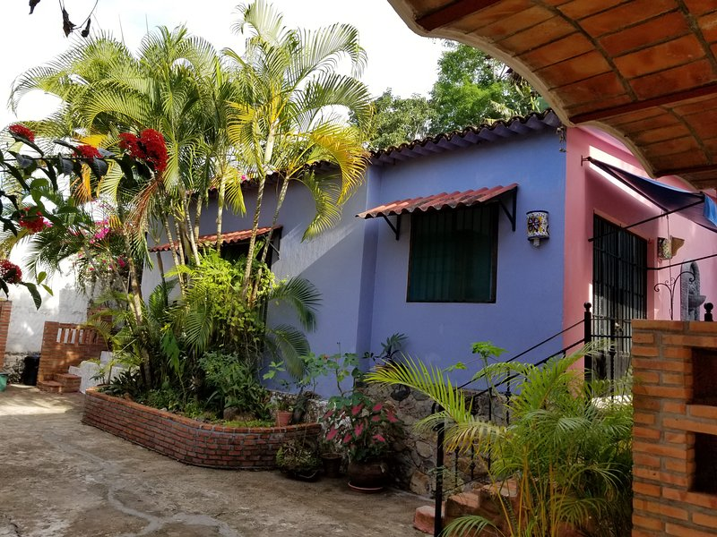 Front of villa inside of compound with pool and Palapa. Nice for 2 or for a family of 5.