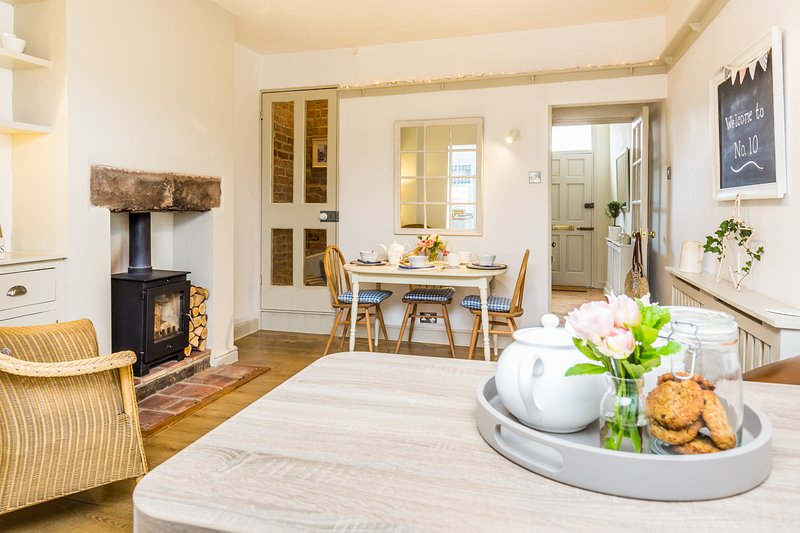 Dining table, wood burning stove and comfortable seating. Digital radio and i phone dock.