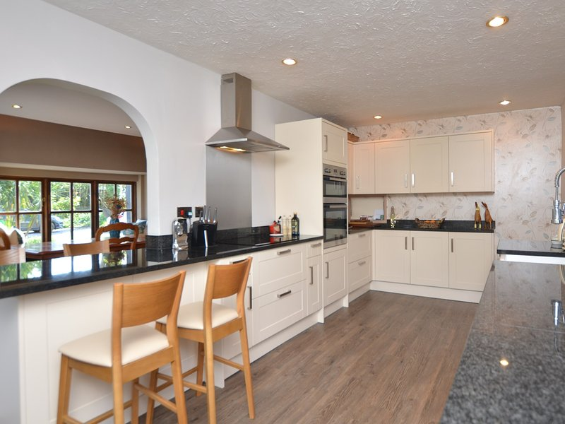 Beautifully presented kitchen with integrated appliances