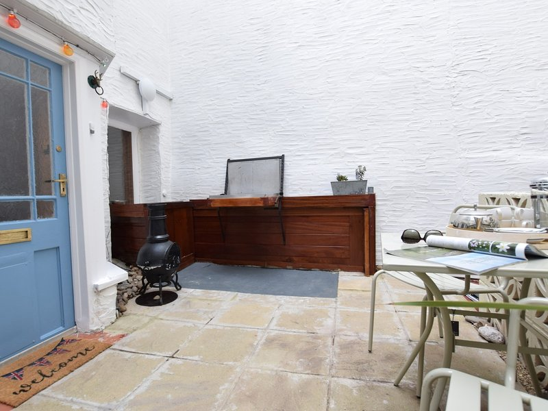 Private courtyard area to the front of the property with BBQ and Chimnea