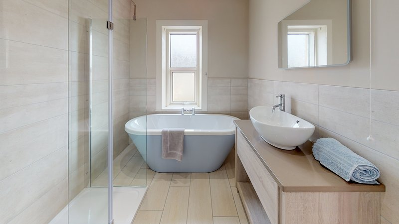 Recently refurbished family bathroom. Freestanding bath and shower.