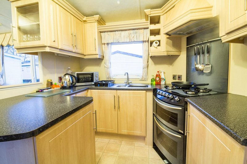 This lovely kitchen in this 8 berth private hire caravan at the Wild Duck Holiday Park.