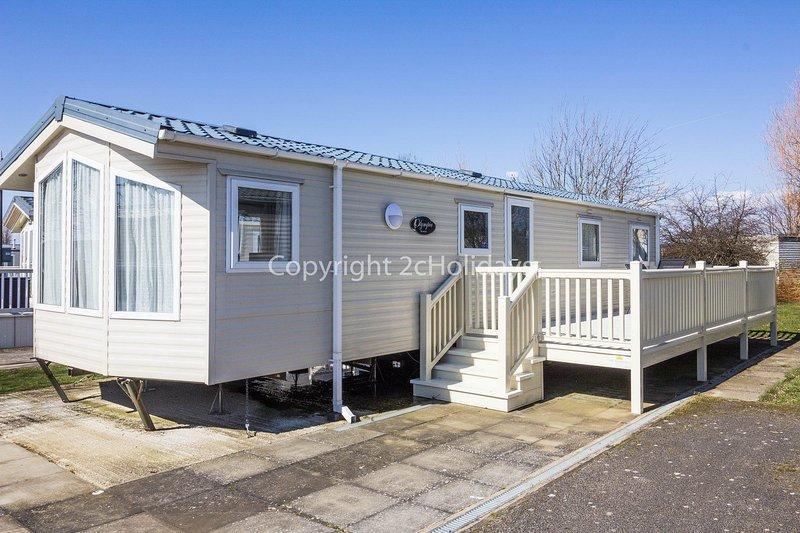 8 berth caravan with decking at Manor Park Holiday Park