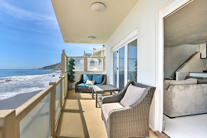 Book your oceanfront Malibu retreat to this luxurious 2-bed, 2.5-bath beach home