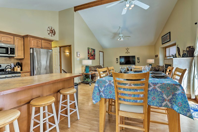 Book a trip to this 5-bedroom, 3-bathroom vacation rental home in Pocono Lake.
