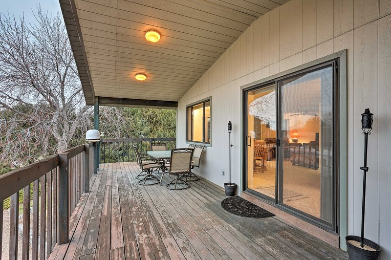Revel in the fresh air on the deck of this Lemoyne vacation rental house.