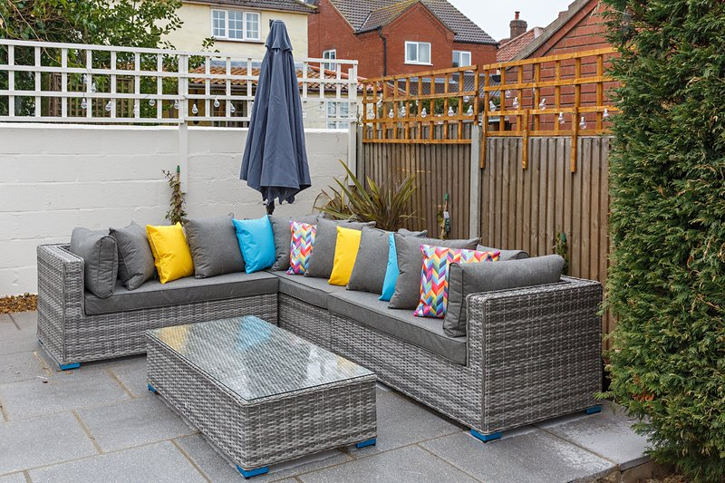 Outdoor sofa and parasol