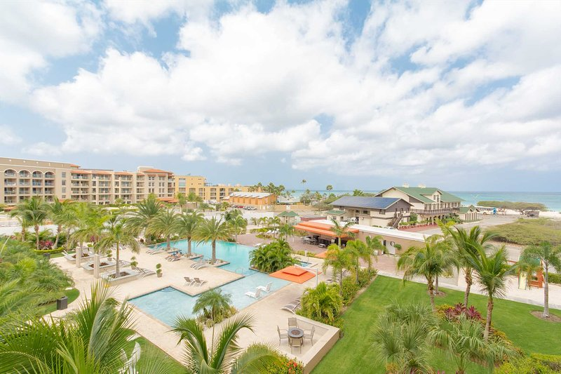 Enjoy the views of the resort and the world-famous Eagle Beach