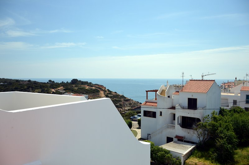 View from private roof terrace of sea and village