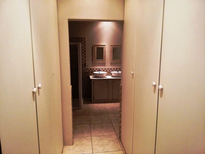 Built in cupboard area leading to En Suite bathroom