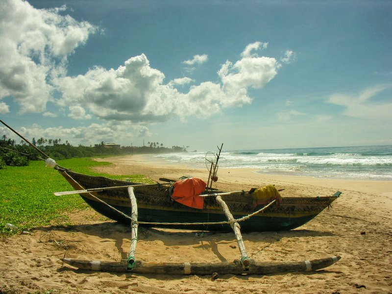 Koggala beach and local style boat
