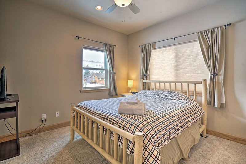 This bedroom includes a queen bed.