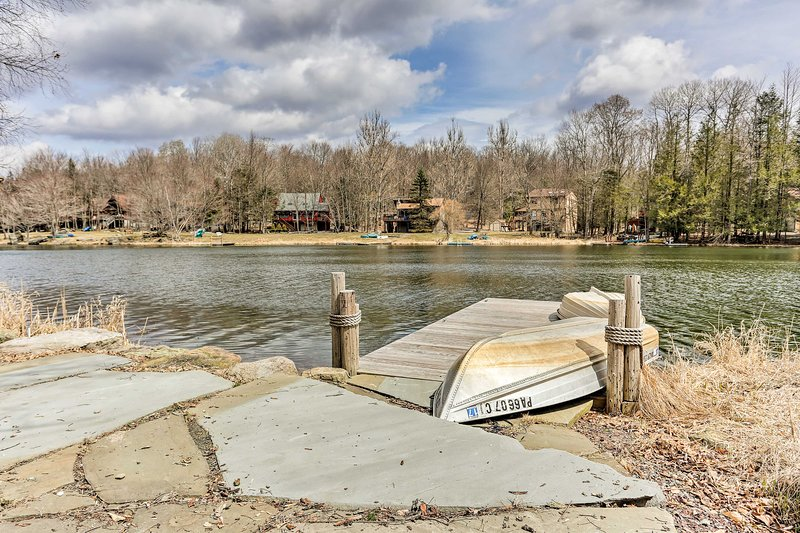 The vacation rental sits on the shore of a small lake, perfect for canoeing.