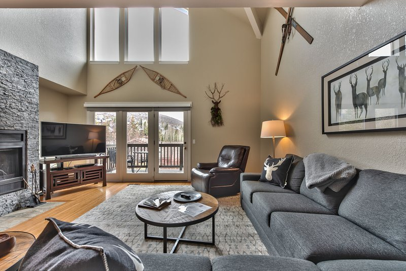 Living room with fireplace, 55' HD Smart TV & DVD, Deck Access