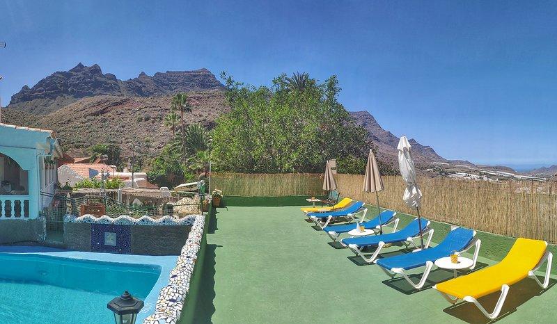 Solarium with hammocks, tables, umbrellas next to the private pool