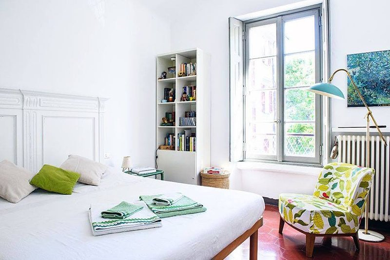 A comfortable double bedroom with a small library.
