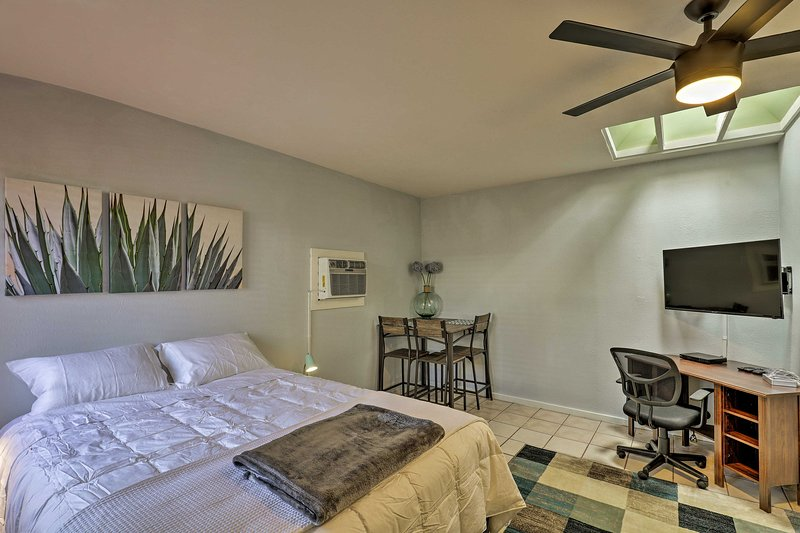 The modern interior boasts a queen bed and full bathroom for 2 guests.