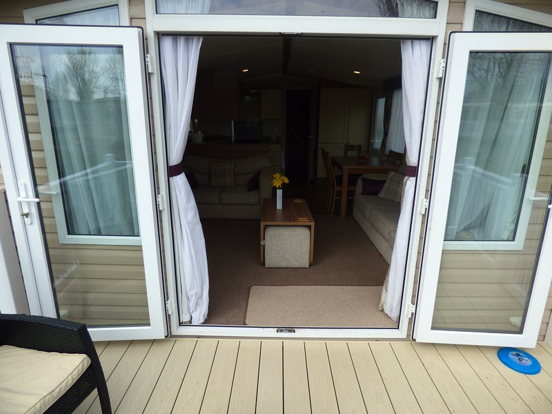 Patio doors from decking to lounge