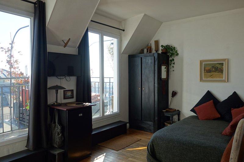 Camera da letto / soggiorno e porte francesi sulla terrazza