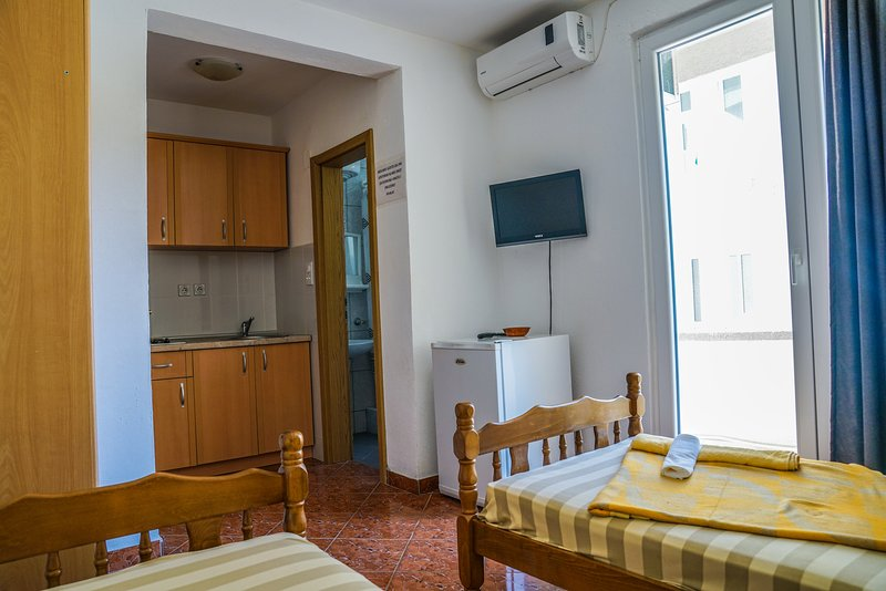Studio is equipped with kitchen , flat screen TV and air condition