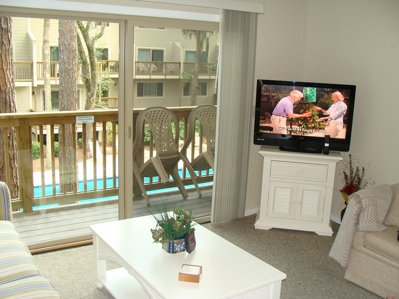 FAMILY ROOM AND DECK OVERLOOKING POOL AND GRILL