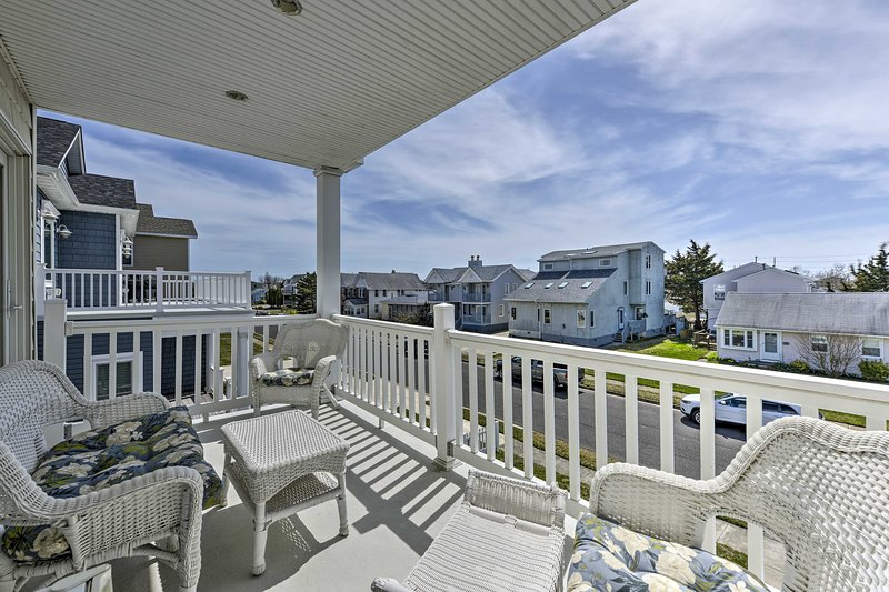 This home boasts a furnished balcony with residential views.
