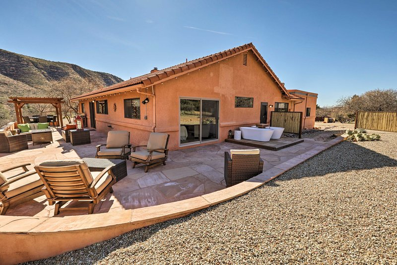 At this vacation rental house, you'll be secluded & surrounded by red rocks.