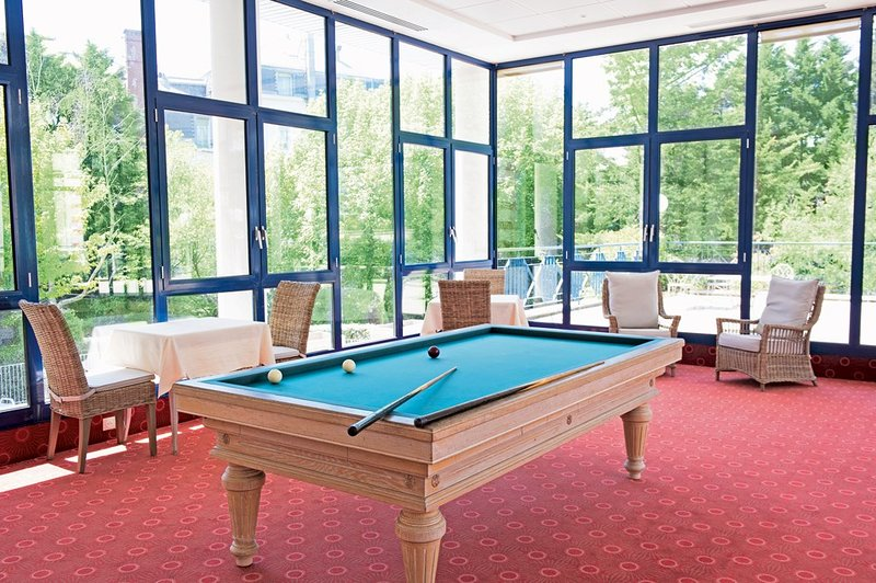 Play a game in the billiards room.