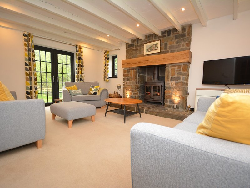 Beautiful lounge with roaring wood burner for cosy evenings in