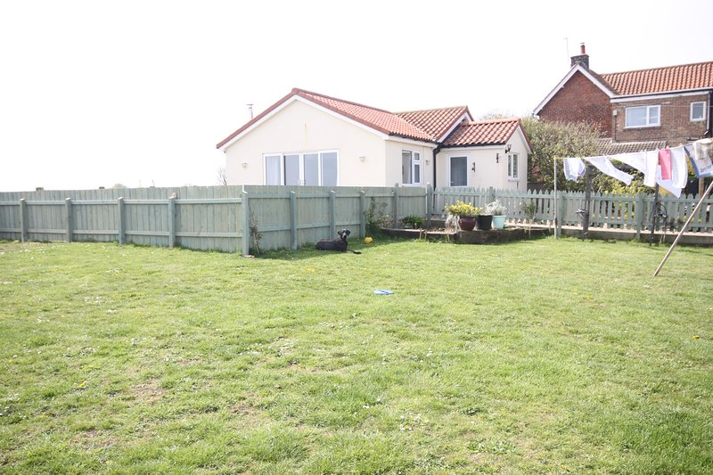 View of Apple Tree from the main garden, fully fenced off for privacy.
