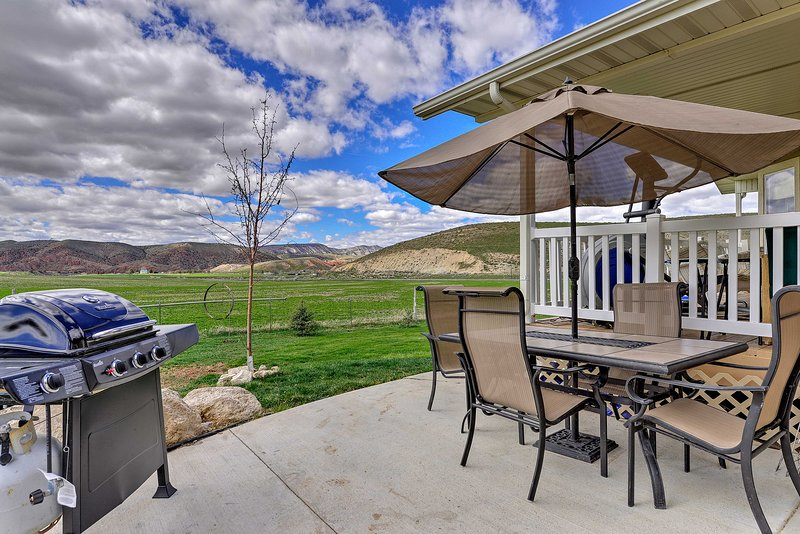 Grill your dinner on the patio and enjoy the mountain views surrounding the unit