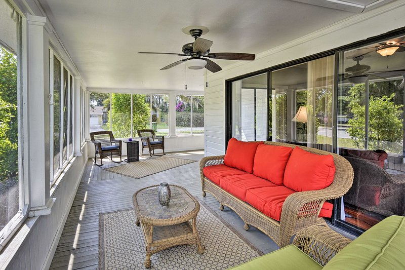 Sit out on the porch with a cocktail while the ceiling fans keep you cool.