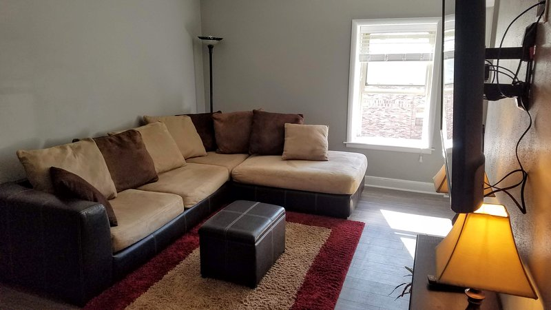 Sectional couch comfortably seats four and can sleep two.