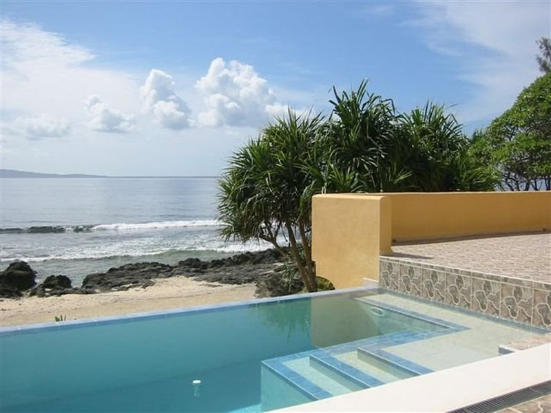 Uniquely Inspired French Villa on private beachfront location, holiday rental in Mele